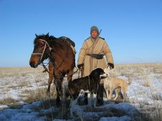 Kazakh shepherd: He and his dogs' primary job is to guard the sheep from predators.