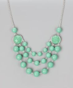 An icy treat for any ensemble, this statement necklace is an ideal way to celebrate fresh fashion. Minty bubbles play up a polished look, while the adjustable length customizes the fit.