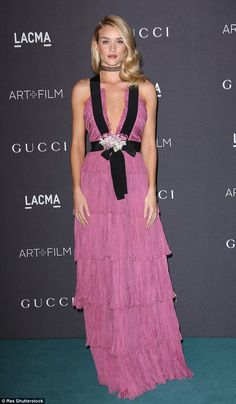 Pretty in pink: Rosie Huntington-Whiteley wore a low-cut pink gown at the LACMA Art and Film Gala in Los Angeles on Saturday
