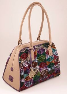 The Michele bag, in unique Mayan huipil and fine leather, by Augusto Castillo www.benare.net