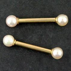 These 14 gauge nipple barbells are made from internally threaded solid yellow 14k gold, both hypoallergenic and nickel free. Both genuine white Japanese culture