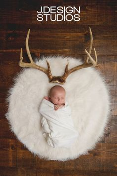 Baby with deer antlers