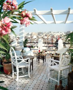 Roger Vivier designer Bruno Frisoni decorated his terrace in Tangier with wooden chairs by Najim & Othman Workshop, and he added an interwoven enamel brick zellige tile scheme. Photographed by François Halard, Vogue, June 2013.
