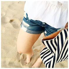 Beach Bumming it with these Rag and Bone Distressed denim, an off the shoulder blouse, and this Target striped beach bag (under $40!!)
