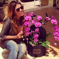 Instagram media by maisondesfleurs_ae - Woman & Orchids always goes well  Thank you @fozaza  for your continuous support with @maisondesfleurs_ae  #maisondesfleursaelovesyou#friends#support#flowerboutique#dubai#events#weddings#uae#delivery#orchids#luxurypackaging