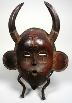 Africa | Face mask from the Senufo people, northern Ivory Coast | Bronze, copper | ca. 1950s by rachelle