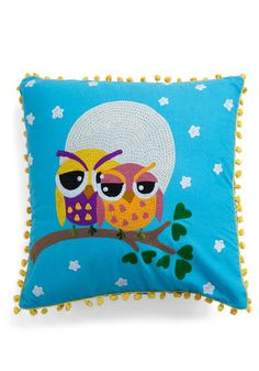 Stitched on the removable sky-blue cover of this square accent pillow, a pair of brightly colored owls enjoys a full moon and a flock of stars from their high-altitude perch, bordered by bright yellow pom-poms. $34.99