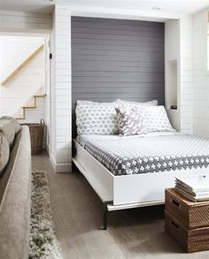 Budget Basement Decorating Tips: Incorporate a guest bed into your existing layout instead of putting up new walls for a separate bedroom