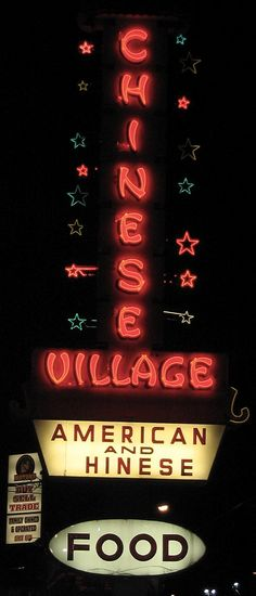 With falling stars. On 82nd Ave. Chinese Village Restaurant sign
