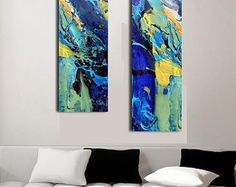 Bold, 2 piece diptych abstract blue ocean paintings printed on large acrylic. Prints on Plexiglas, or glass prints, are the latest trend in displaying coastal art. Sleek, chic and sophisticated. Its clean design is very popular in contemporary interiors and complimentary with modern home decor. Available in 3 large wall art sizes to perfectly fit your space. A 1/4 thick acrylic sheet holds this gorgeous Limited Edition print of my original resin art painting, Down by the Seaside by Jane ...