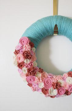 aqua and pink yarn wreath with felt flowers