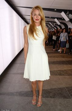 All white: Cat Deeley attended London Fashion Week's Whistles show in the Kings Cross Tunnel on Saturday
