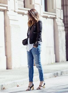 Black Balenciaga leather jacket with distressed Zara jeans and heels from Senso