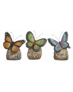 Set of Three Polystone Butterflies in Assorted Sizes - This polystone interior decor item is the best to showcase the creativity in polystone while also conveying your feeling openly to your dear ones. This set of polystone butterflies is a great gift idea for your loved ones on occasions like birthdays, Valentine's Day, New Year, anniversaries, etc. The beautiful butterflies designed in attractive colors pass your messages to them in a lovable manner.