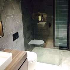 This amazing bathroom from our North Manly store may just finally confirm that our Esagono Hex and Arkitek Grey tiles are made for each other.