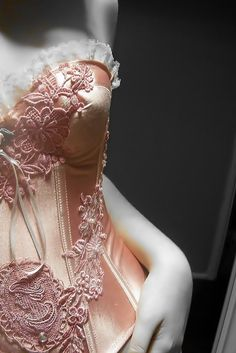5156fa64d8 exquisite hand beading on this pink satin and lace corset