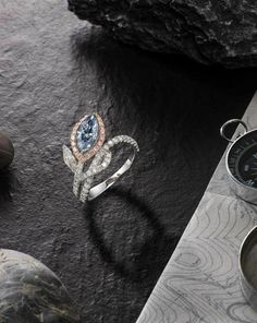 A Marquise-Cut Fancy Greyish Blue  Diamond and Diamond Ring