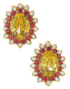 I bet you can tell from the color combination of these gold, ruby, citrine and diamond earrings that they're retro. They're by David Webb and date to the 1960s.  (Via Phillips.)