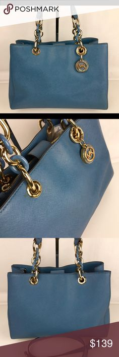 """Michael Kors Cynthia Medium Satchel - Pale Blue Condition: Gently used. One small blemish near chain grommet. See photos.   This satchel is replete with sophisticated details, from its leather-trimmed chain-link handles to the convertible, buckle-fastened shoulder strap. An array of interior pockets and a top-zip closure keep all of your essentials organized and secure. Crafted from sumptuous leather that gets better with time. 12-1/2"""" W x 9-1/4"""" H x 5"""" D. Style 30S3TCYS2L. Our bag # RB124…"""