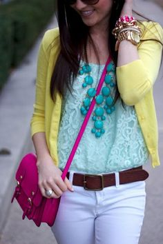 Yellow cardigan, turquoise top and statement necklace, white skinny jeans, and hot pink bag