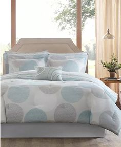 Freshen up your bedroom décor with the Madison Park Essentials Knowles Comforter Set. A circular print in different shades of grey and aqua adorn the soft comforter set, adding a clean, modern look to your bedding.