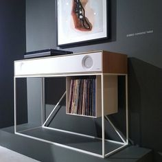 English furniture maker Hugh Miller's Folded Record Bureau is a play on both form and function, incorporating the features of a vintage 1985 Bang & Olufsen BeoGram 5000 turntable, complete with original controls, installed flush into a long record shelf w Record Shelf, Vinyl Record Storage, Record Player Console, Vinyl Shelf, Audio Design, Speaker Design, Espace Design, Magazine Storage, Audio Room