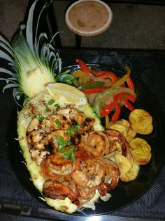 Jerk Chicken && Shrimp Pineapple Bowl with Jasmine Seasoned Rice, Fried Plantains, and Jerk Veggies (luau food fried rice) Pineapple Bowl, Pineapple Recipes, Seafood Recipes, Cooking Recipes, Luau Food, Summer Dishes, Food Goals, Food Cravings, Relleno