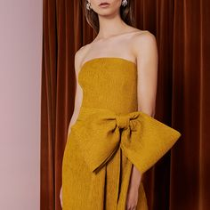 Whether its with a statement bow or a sculpted silhouette, Rebecca Vallance's dresses always strike a feminine note.