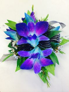 Teal/purple orchid on black wrist band wrist corsage