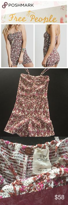 """Free People romper Free People Misty floral smocked romper, size medium.  Cute form fitting romper with tube top smocking throughout!  Adjustable straps, shorts have a 3 1/2"""" inseam.  NWOT Free People Shorts"""