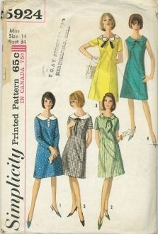 An original ca. 1965 Simplicity Pattern 5924.  Juniors' and Misses' One-Piece Dress with Five Neckline Trims: The A line dress has round neckline, back zipper closing and long front darts. V.s 2, 3 and 5 have short set-in sleeves. V. 1 with long set-in sleeves has contrasting collar and button trimmed tab. V. 2 has matching tie collar. V. 3 has contrasting petal collar, braid or top-stitching trim and ribbon knot. Sleeveless V. 4 has matching collar and bow.