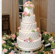 Five-tiered, five-flavored pound cake decorated with white lattice and flowers.