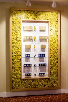 Love the flower wall, such a creative way to put items on display, beautiful retail design Display Design, Booth Design, Store Design, Cosmetic Display, Cosmetic Shop, Beauty Salon Decor, Retail Interior, Salon Design, Retail Shop