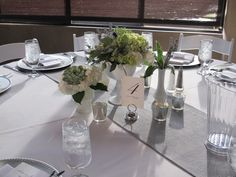 Milk glass centerpieces with grey burlap runners