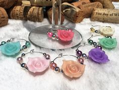 Flower Wine Charms Rose Wine Glass Charm Set of by LasmasCreations Wine Favors, Summer Party Decorations, New Things To Try, Wine Decor, Housewarming Gifts, Wine Glass Charms, Wine Parties, Purple Glass, Product Ideas