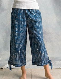 Trichy Pants: Wide leg flood pant with cute tie detail at leg opening features relaxed fit, full elastic, easy fit through hip and thigh, front pockets and wide leg. Soft and drapey in voile with cotton lining. 100% cotton.   Made by Nirmaan