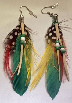 Dangle earrings Feathers by theMrMoustacheShop on Etsy, $5.25