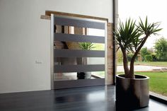 Synua bespoke pivot door by Oikos Venezia www.oikos.it