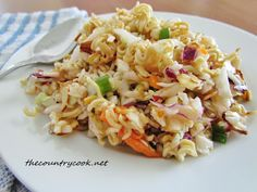 Crunchy Asian Slaw.... I know y'all have seen this fun little salad grace many a picnic table.  It seems everyone has a recipe for it with small variations here and there.  But they are all usually delicious and it's something a little different for your guests to try (and get hooked on).