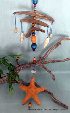 Made with vintage wooden beads ..decor beach mobile  Star fish sea shell driftwood beaded by CarmelasCoastalCraft, $22.00