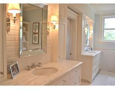 Tile behind the mirror with sconces