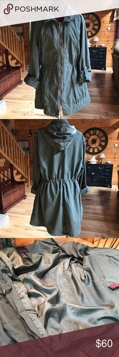 YOKI Olive Utility Cargo Jacket Brand new lined lightweight jacket with drawstring waist.  Rain repellent hood hidden in zippered neck compartment.  Sleeves can be worn down or rolled with snapped closure.  Slit at bottom on back with decorative tie. Yoki Jackets & Coats Utility Jackets