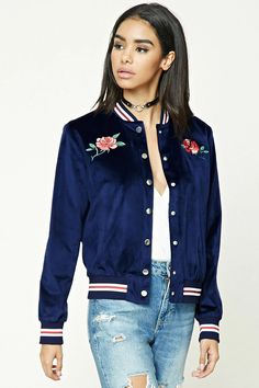 "A velvet jacket featuring a ""Heartbreaker"" and floral embroidered graphics, high-polish snap-button front, contrast ribbed trim, two front slit pockets, and long sleeves."