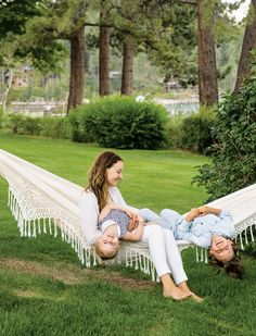 mom and kids lounging in a crochet hammock