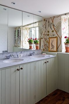 Cannot get enough of the panelling, wallpaper and terracotta pots in this bathroom. The wallpaper is 'Adams Eden' by Lewis & Wood. From the November 2013 issue of House & Garden.