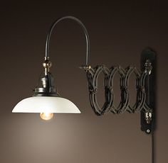 SWING ARM SCONCE / RESTORATION HARDWARE / $110