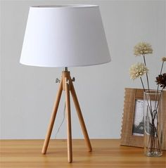 Whether you prefer to unwind in the evening with a good book, play games on your phone, or catch up on the day with your partner, the right bedside lighting can Bedside Lamps Wood, Unique Bedside Tables, Tripod Table Lamp, Nightstand Lamp, Bedside Lighting, Home Design Decor, Design Ideas, Latest House Designs, Light Decorations