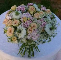 Handtied bouquet with white nigella, pink roses, pink sweetwilliams and white ammi.