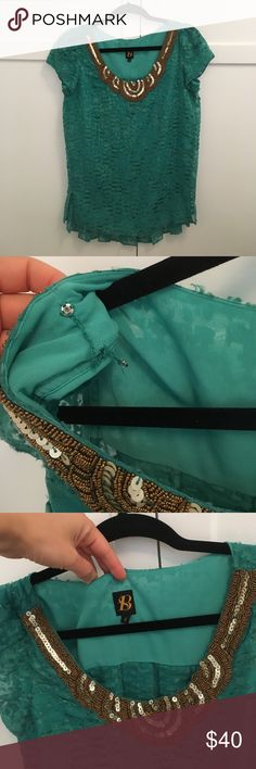 Stunning teal beaded shirt from anthropologie Sheer outer & back, front is lined. Worn twice to church, just a little too big for me. Bra strap snaps both in good working condition. Even more beautiful in person, all the beading is intact. Anthropologie Tops Blouses