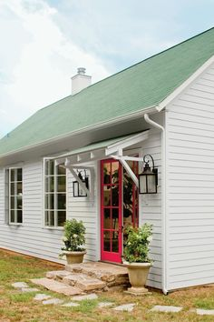 french doors and stone stoop under a simple wood overhang and large lanterns Front Door Overhang, Front Door Awning, Porch Awning, Patio Awnings, Front Entry, Roof Overhang, House Awnings, Large Backyard Landscaping, Backyard Ideas